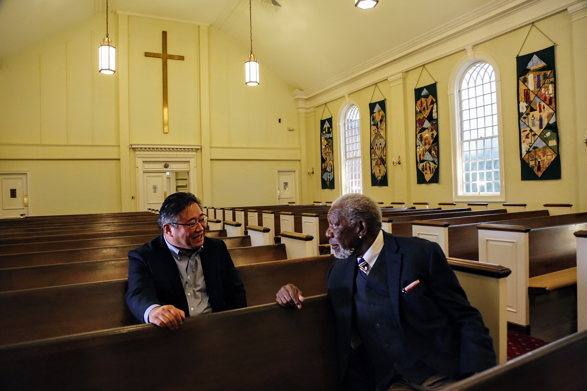 BETHESDA, MD - Former North Korean prisoner and Christian Minister Kenneth Bae shares his experience with Morgan Freeman inside the Concord Saint Andrews United Methodist Church. (Photo Credit: National Geographic/David Kraemer)