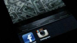 A photo illustration shows the applications Facebook and Instagram on the screen of an iPhone in Zagreb April 9, 2012.  REUTERS/Antonio Bronic/Files