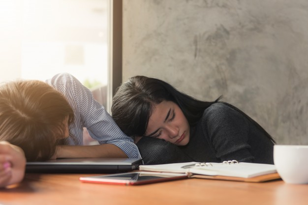 asian-business-woman-in-the-office-tired-overworked-woman-resting-while-she-was-working-writing-notes-overwork-and-stress-concept_1253-1009