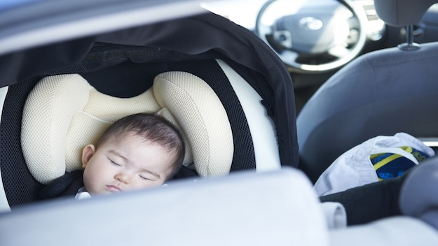 baby sleeping in child car seat